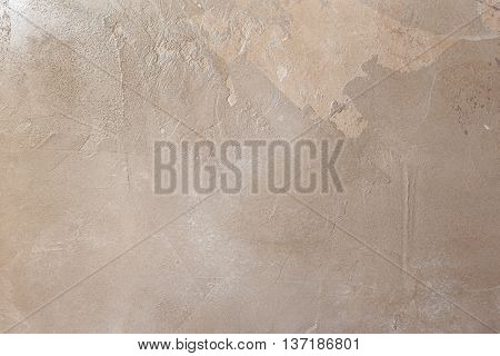 Texturized chocolate brown putty. Vintage or grungy background of venetian stucco texture as pattern wall.