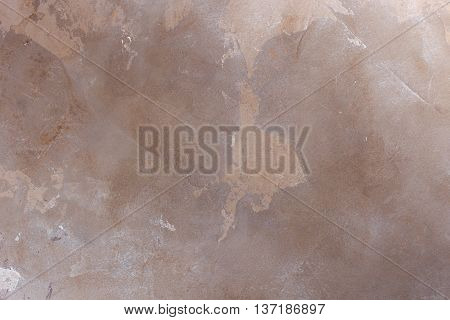 Texturized brown and beige putty. Vintage or grungy background of venetian stucco texture as pattern wall.