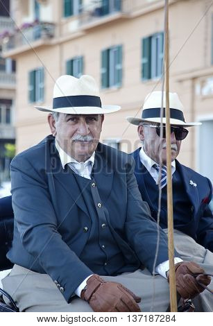 Naples Italy July 02 2016: two participants of the parade of carriages with actors in costumes to commemorate the three hundredth anniversary of the birth of Charles of Spain who was King of Naples