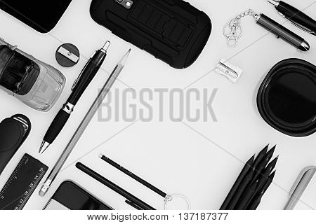 Stylish office workplace in black on a white background. Male strict style. Presentation. Frame. Blank notebook. Monochrome.