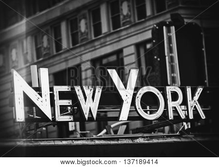 New York signage made from neon tubes with grunge filter in black and white