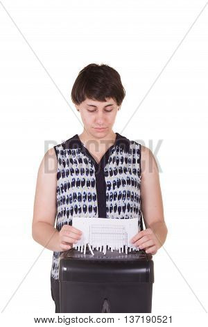 A young business woman shredding a documen