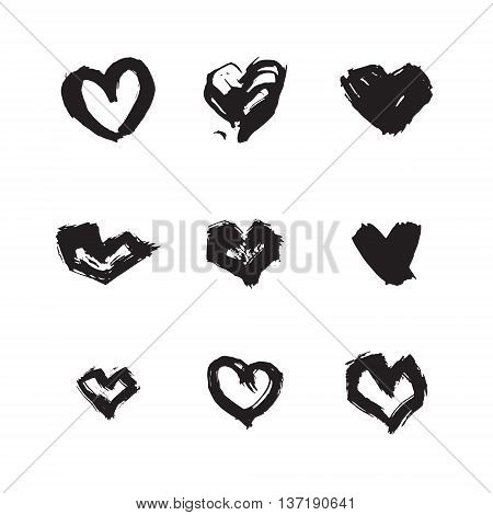 Hand drawn ink heart symbol set. Abstract vector black textured brush heart shape isolated on white background.