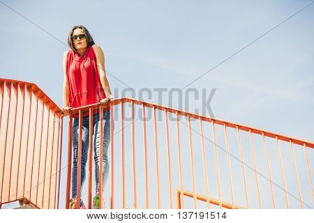 Girl On Bridge In City.