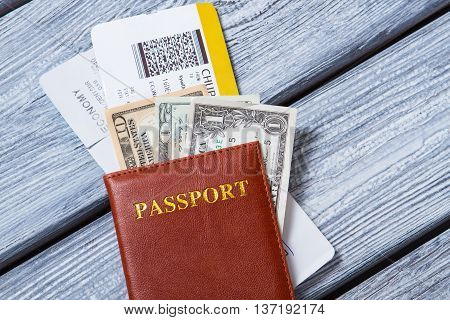 Passport on USA dollars. Document and tickets. Take a trip to abroad. Spend summer in another country.