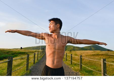 Healthy muscular young man doing sport at outdoors