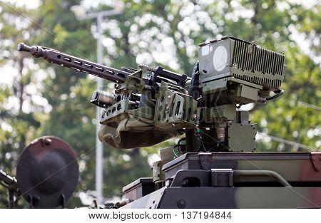 machine gun on a military army vehicle