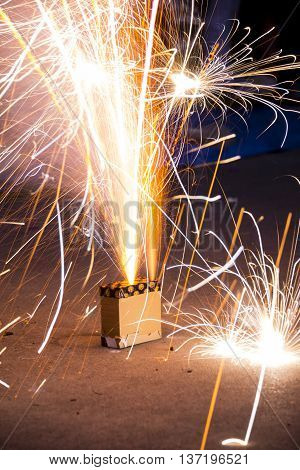 July 4th box firecracker going off on a sidewalk in slow motion