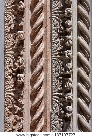 Detail from Sant Maria Gloriosa dei Frari medieval portal with spirals anf flowers