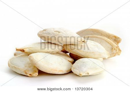 Extreme close-up image of pumpkin seeds studio isolated on white background