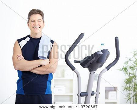 Gym & Fitness. Smiling man working out.