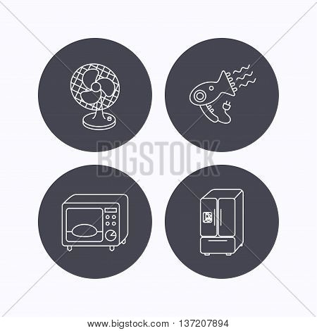 Microwave oven, hair dryer and ventilator icons. American style refrigerator linear sign. Flat icons in circle buttons on white background. Vector