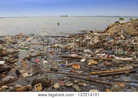 SANDAKAN, MAlAYSIA - CIRCA JULY 2016: Plastic bottles and bags pollution of water at sea side beach.