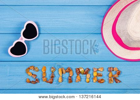 Word Summer Made Of Amber Stones, Sunglasses And Straw Hat On Blue Boards, Summer Time, Copy Space F