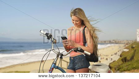 Lovely Young California Woman At Beach Texting Bicycle Owner To Pick Up His Bike