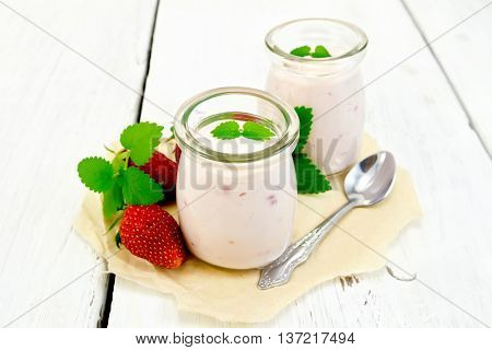 Yogurt With Strawberries In Jar On Paper And Board