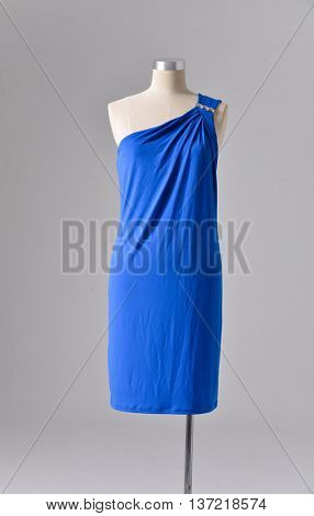 female blue dress on dummy-gray background