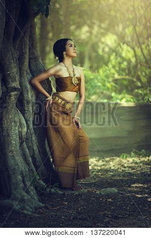 Asian Thai woman in Thai traditional dress outdoor