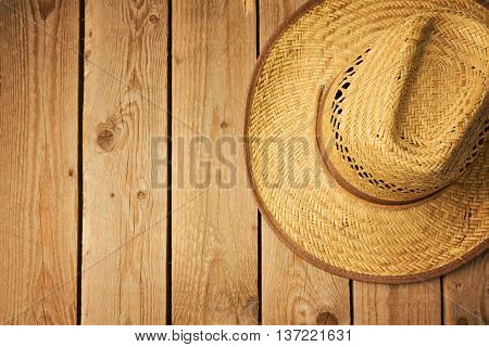 Cowboy hat on wooden vintage table. View from above