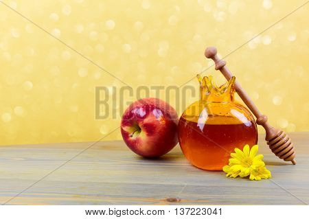 Honey pomegranate jar and apple on wooden rustic table. Jewish holiday Rosh Hashanah background