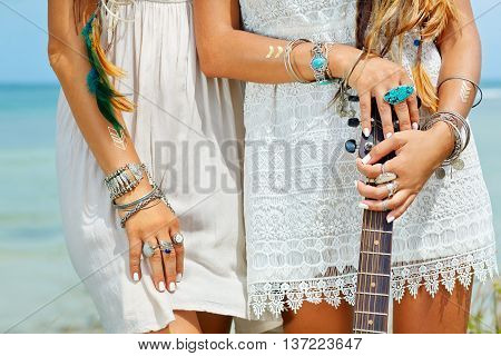 close up of women hands and legs. boho style