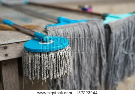 Outdoor use mops, home work and cleaning concept.