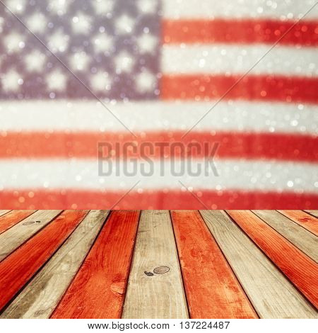 Empty wooden deck table over USA flag bokeh background. USA national holidays background. 4th of July celebration. Ready for product display montage.