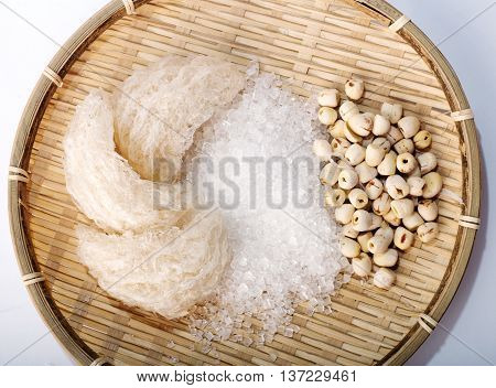 Bird's nest or salanganes with lotus beans on a white background