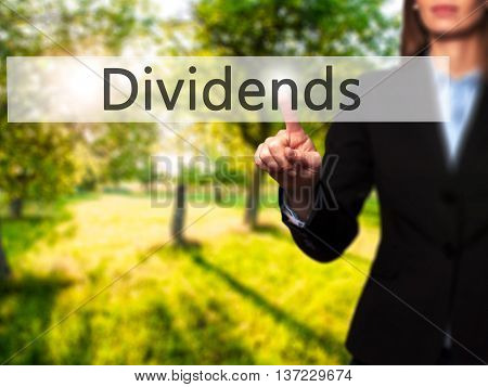 Dividends - Business Woman Point Finger On Push Touch Screen And Pressing Digital Virtual Button.