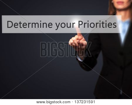 Determine Your Priorities - Business Woman Point Finger On Push Touch Screen And Pressing Digital Vi