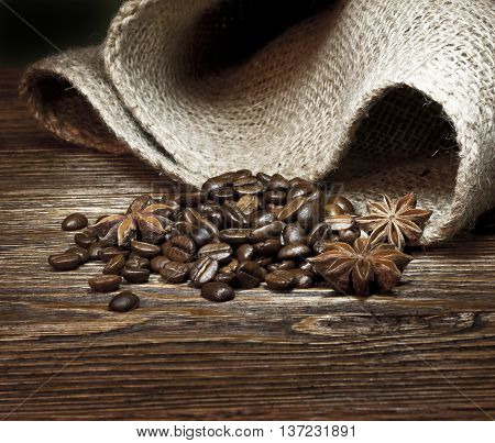 roasted coffee beans on a dark wood background