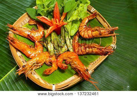 Grilled shrimp on vietnamese roof tile that serving in the restaurant