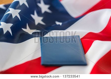 citizenship, patriotism and nationalism concept - close up of american flag and passport