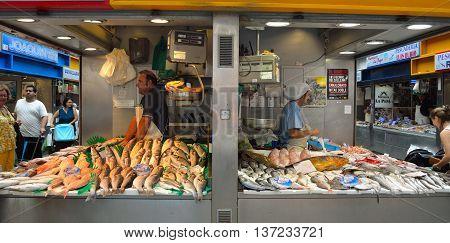 Malaga, Andalucia, Spain - June 29, 2016: Stalls and traders at the Fish Market Malaga.