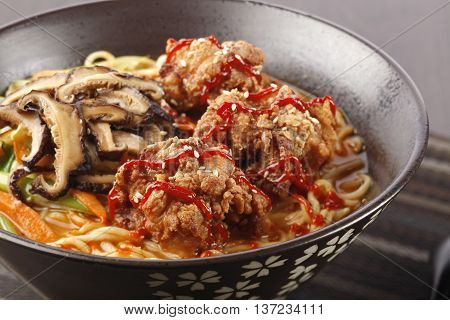 The chicken in Karaage Tantamen with deep-fried boneless chicken and shiitake mushrooms and a few other vegetables
