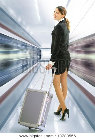 Business traveler with luggage and speed train on station