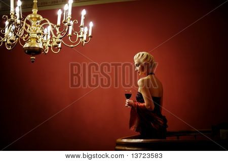 Attractive lady with a glass of red wine