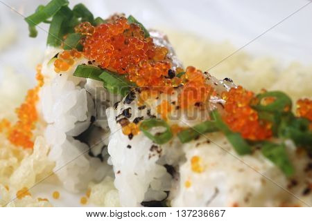 Delicious Japanese sushi roll with fish roe