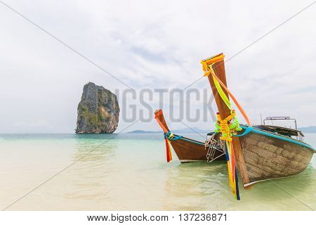 Thai boats and landmark at Po-da island Krabi Province Andaman Sea South of Thailand.