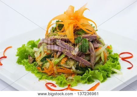 Salad of smoked beef with seasoned pepper in Thai style