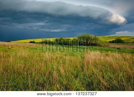 Landscape - meadows with thunderclouds over them. Carpathian Ukraine