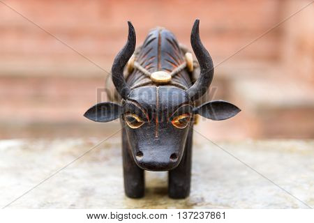 Artistic wooden Yak carrying goods is on sale in the street of Nepal.