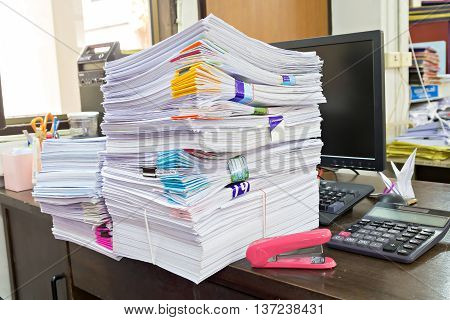 Calculator, Staple And Business Documents Stack On Table