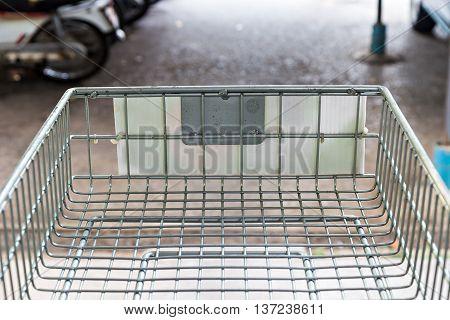 Shopping cart on a car park near supermarket