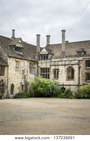 LACOCK ABBEY, LACOCK, WILTSHIRE, UK, 21 JUNE 2016 - Part of the Tudor courtyard at Lacock Abbey Wiltshire UK