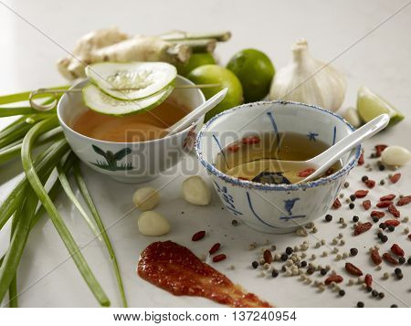 Fish sauce with spices on white background