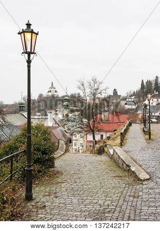 Banska Stiavnica in Slovak republic historical center and New castle. Cultural heritage. Vertical composition. Architectural scene. Street lights.