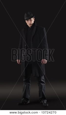 Man in black cloth stand