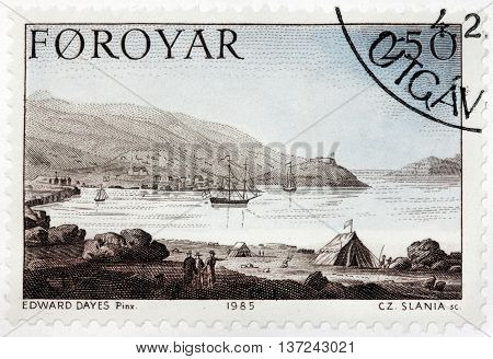 LUGA RUSSIA - JUNE 25 2016: A stamp printed by FAROE ISLANDS shows view of Torshavn Harbor. Engraving after drawing by painting of famous English watercolour artist Edward Dayes circa 1985.