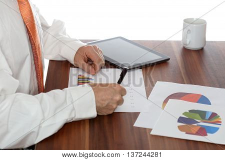 business man is working on different documents